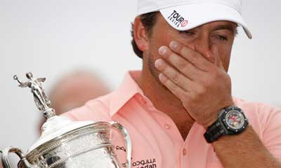 Graeme McDowell holding U.S. Open trophy at Pebble Beach
