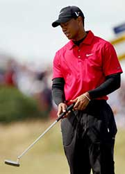 Tiger staring at putter